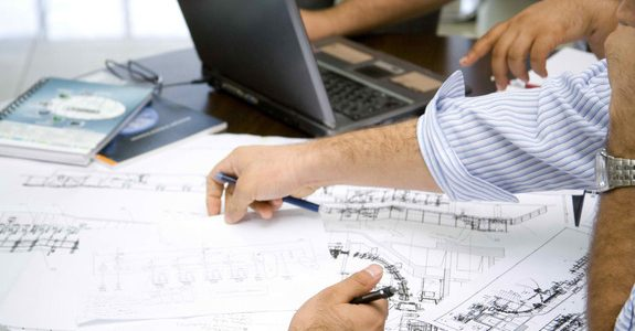 Image of Team of engineers working on drawings