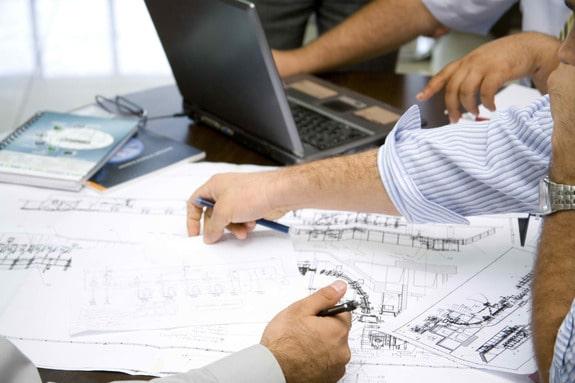Image of Team of engineers working on drawings